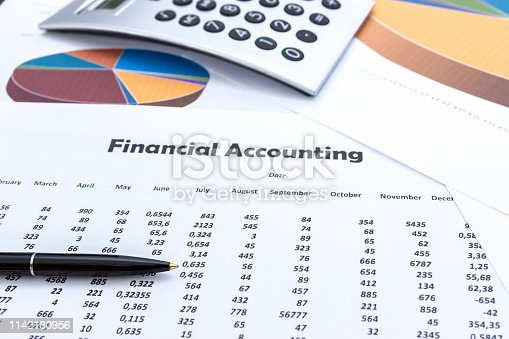 istock calculator and stationery items on the table, Financial accounting. 1142180956
