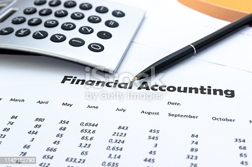 istock calculator and stationery items on the table, Financial accounting. 1142182793