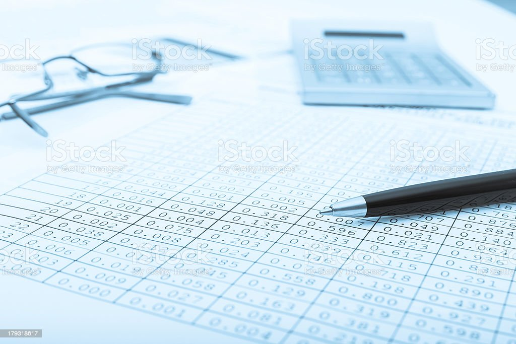 Calculator and the financial report blue toned.Financial royalty-free stock photo