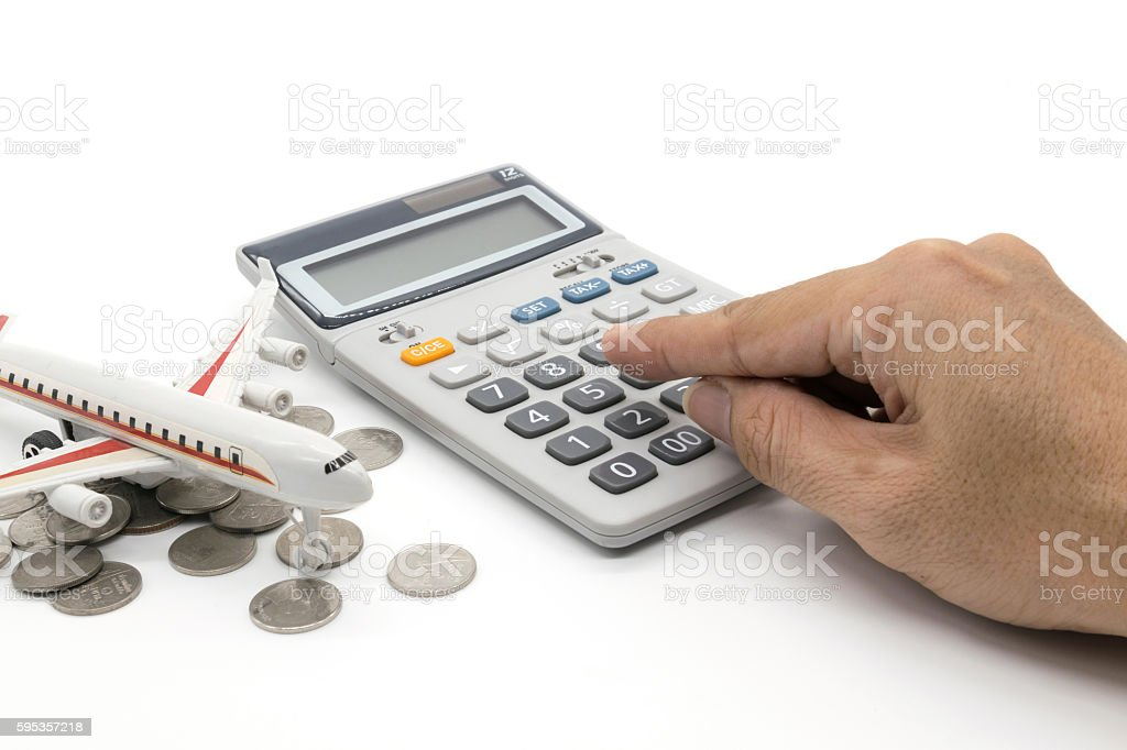 Calculator and toy plane and hand on white background stock photo