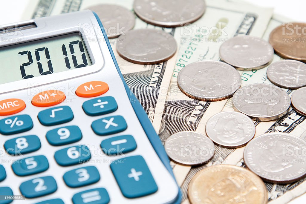 Calculator and US Currency royalty-free stock photo