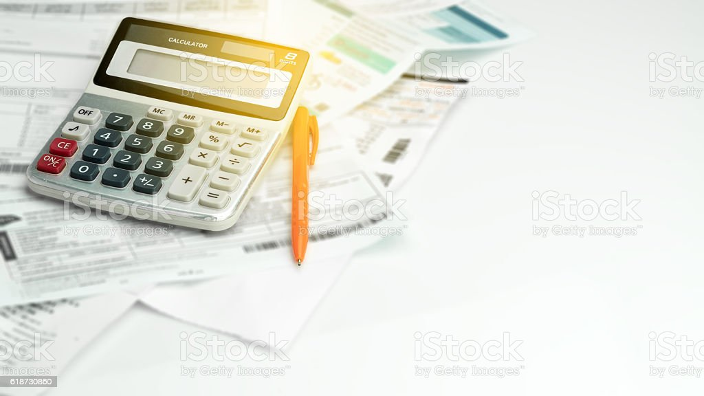 Calculator , ball pen and household bills stock photo
