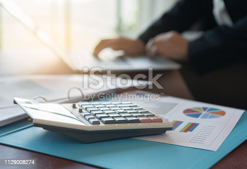 675825950 istock photo Calculator, business and financial report 1129008274