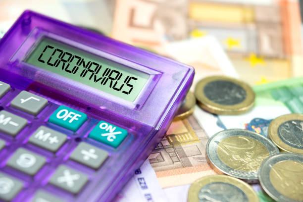 Calculator, Euro banknotes and coronavirus in Europe Taschenrechner, Euro Geldscheine und Coronavirus in Europa european union currency stock pictures, royalty-free photos & images