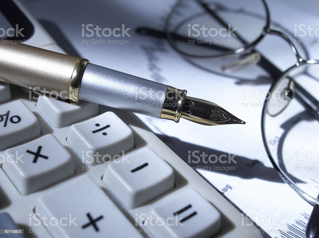 Calculator, fountain pen, glasses and stock chart royalty-free stock photo