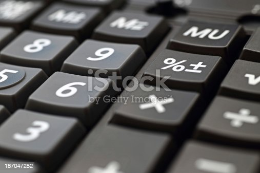 Calculator keypad close up with focus on percent sign.