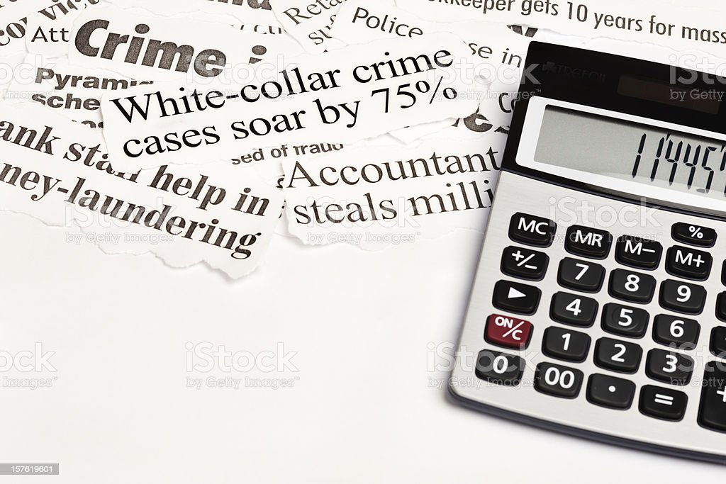 Calculator next to headlines about white collar crime stock photo