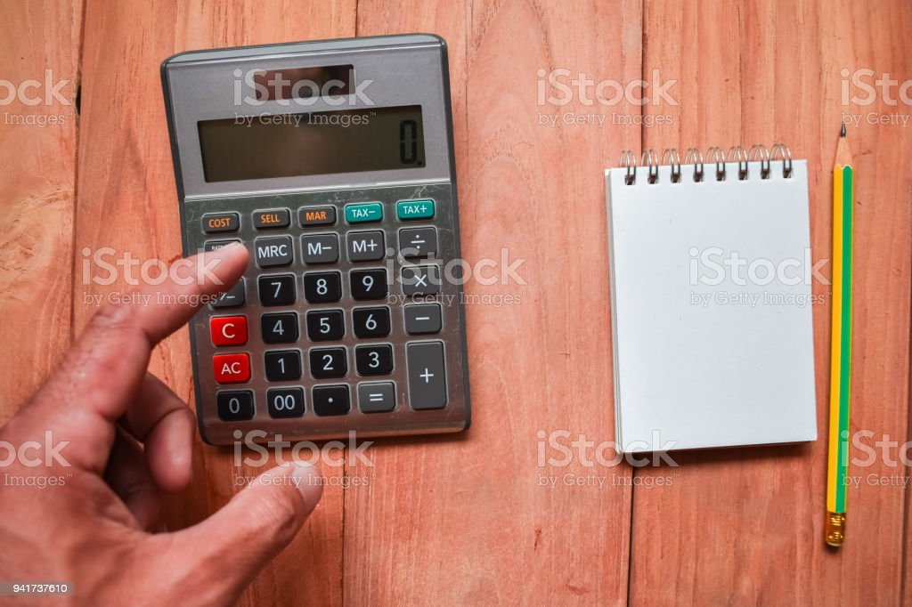 Calculator Notepad With Pencil On Wood Board Backgroundusing