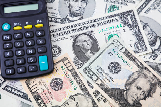 Calculator on American banknotes stock photo