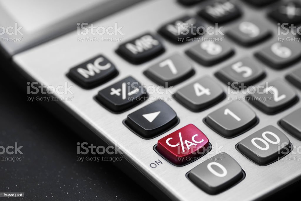 calculator on black and white on C/AC button is red color stock photo