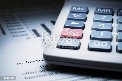 istock Calculator on chart of financial analysis and graphs 183367591