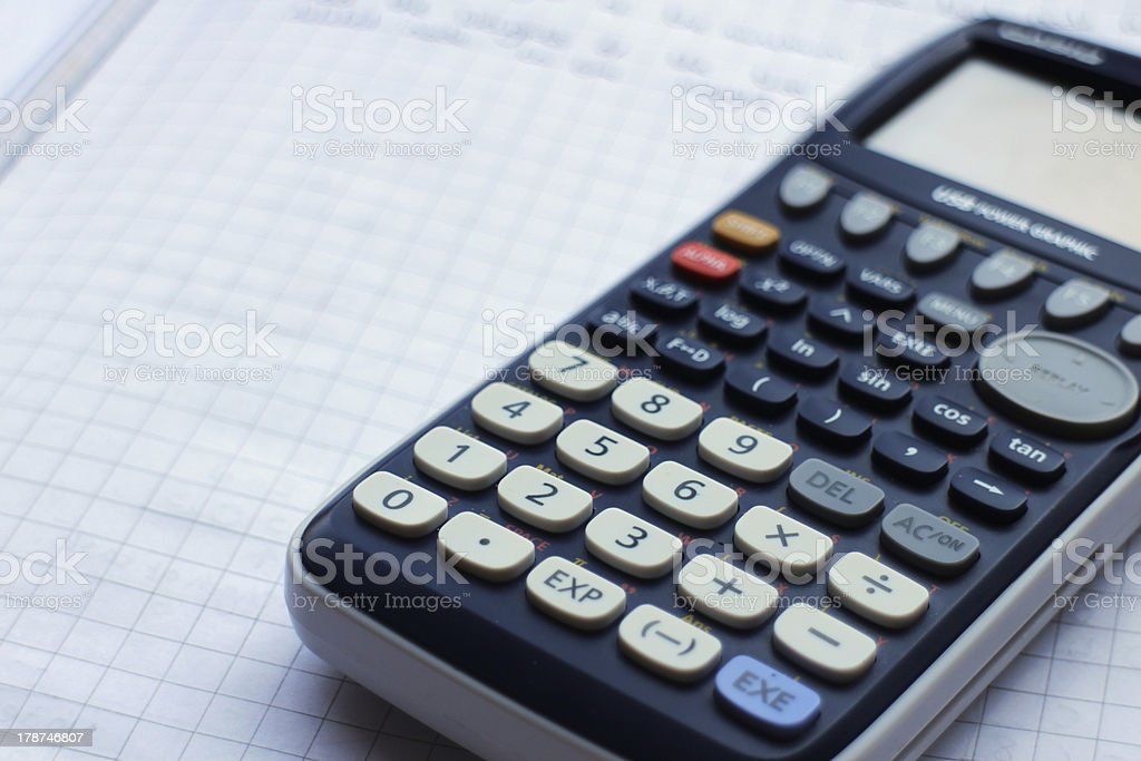 Calculator on Grid Paper royalty-free stock photo