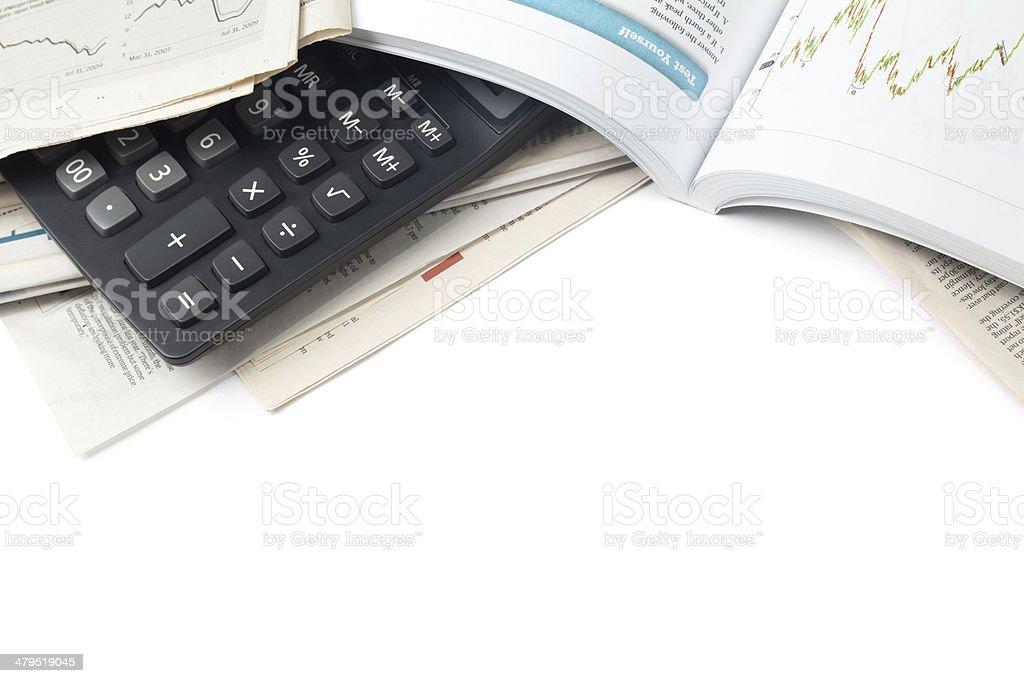 Calculator on Newspaper royalty-free stock photo