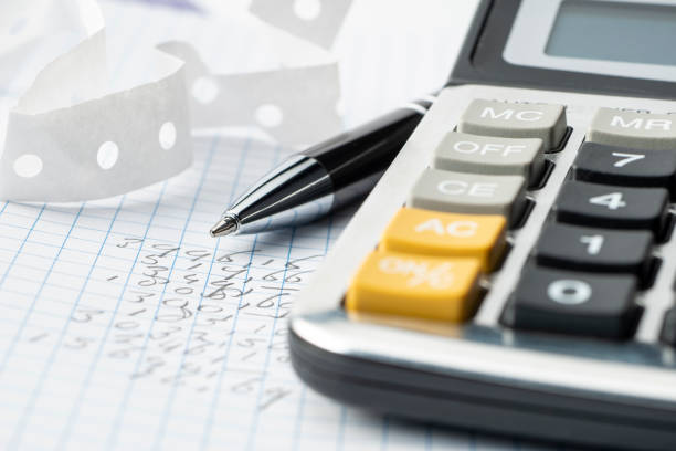 calculator on top of some financial data stock photo