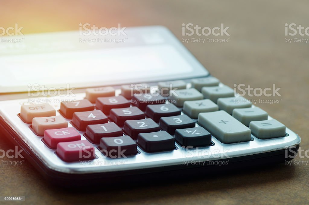 calculator on wood table stock photo
