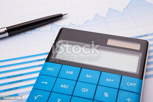 istock Calculator, pen and business balance 1043461296