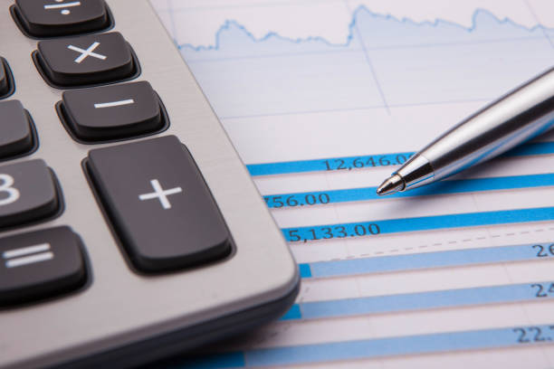 Calculator, pen and business balance stock photo