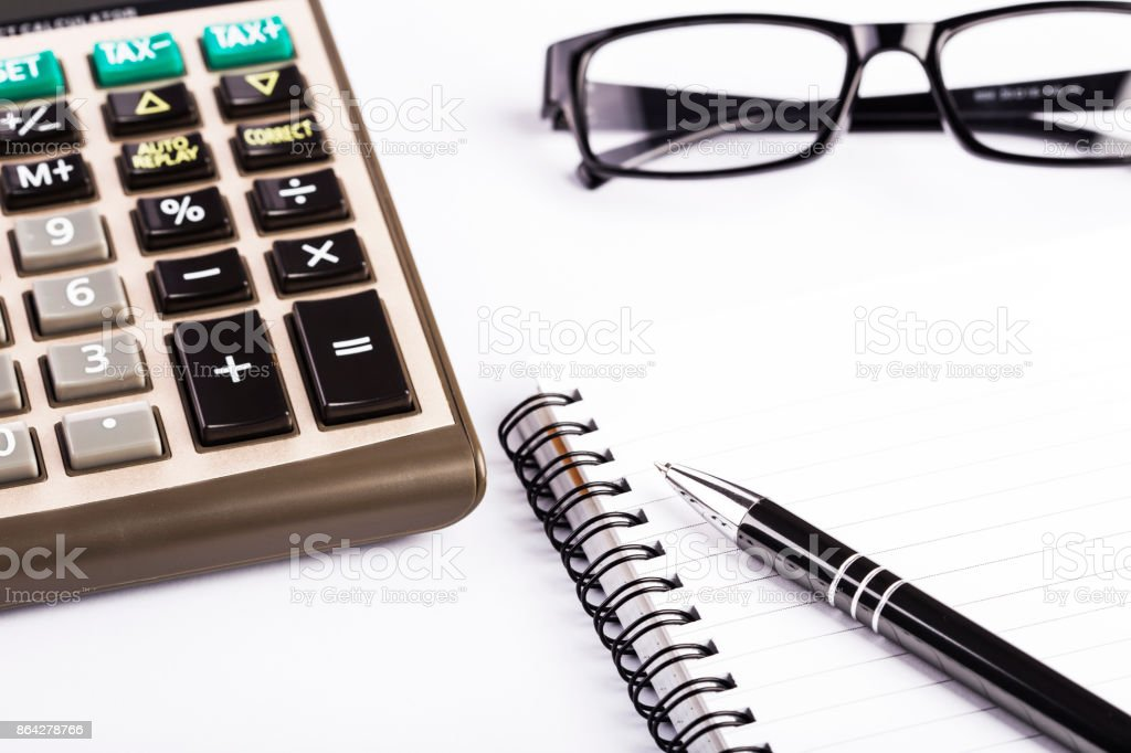 Calculator, pen and glasses isolated royalty-free stock photo