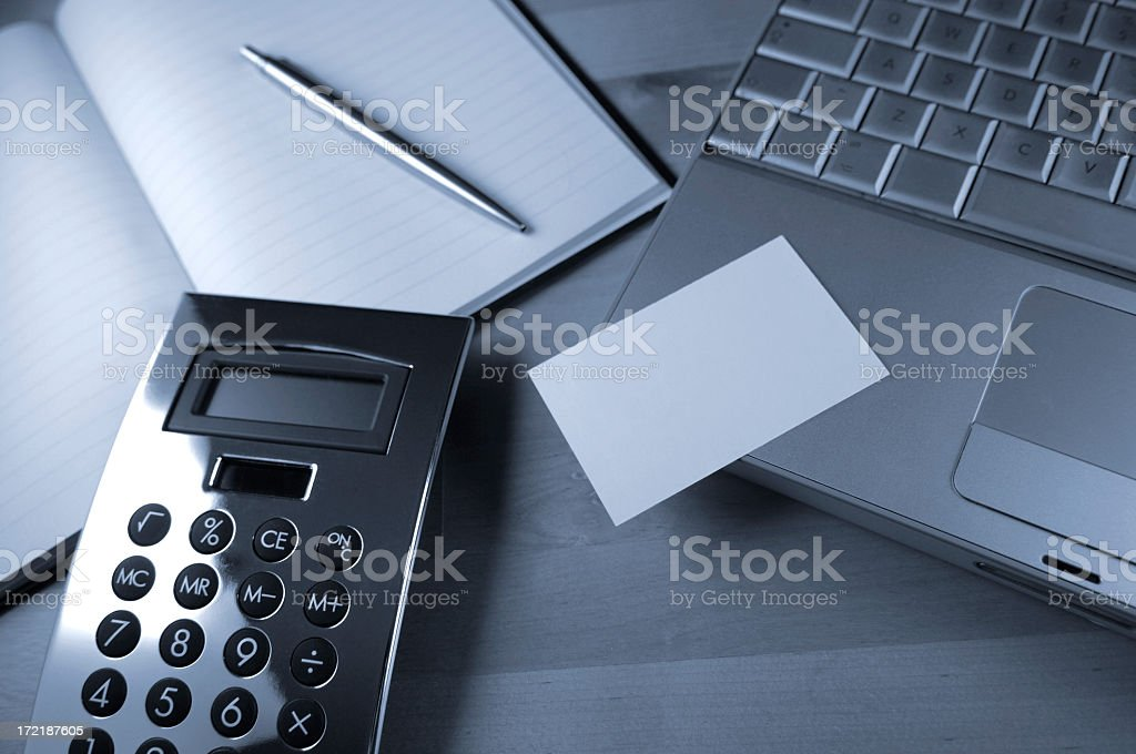 Calculator, Pen, Book and Computer on Desk royalty-free stock photo