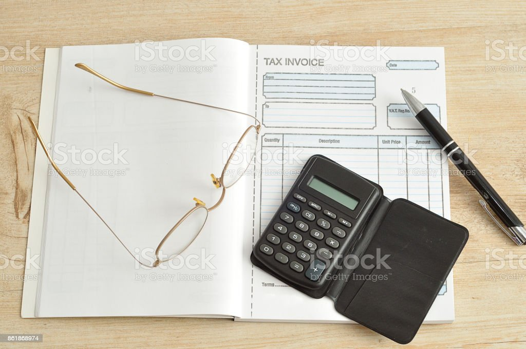 Calculator Pen Glasses And Invoice Book Stock Photo More Pictures