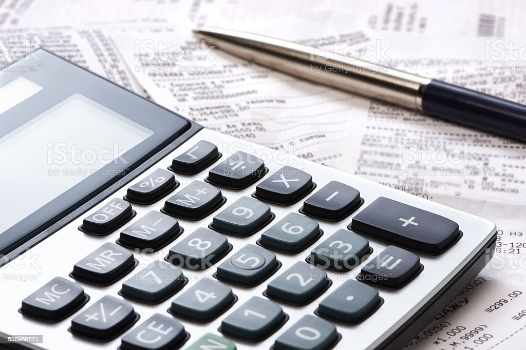 Calculator, pen, receipts stock photo