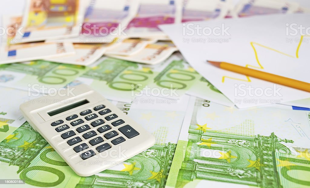 calculator, pencil and diagram royalty-free stock photo