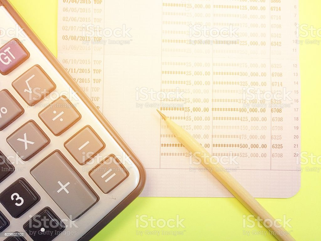 Calculator, Pencil And Savings Account Passbook On Yellow Background  Royalty Free Stock Photo