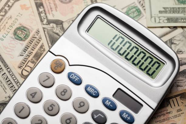 Calculator. Close-up of Money and Calculator with One Million on the Display millionnaire stock pictures, royalty-free photos & images