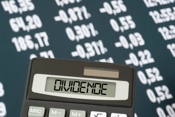 A calculator, stock exchange and the dividend stock photo
