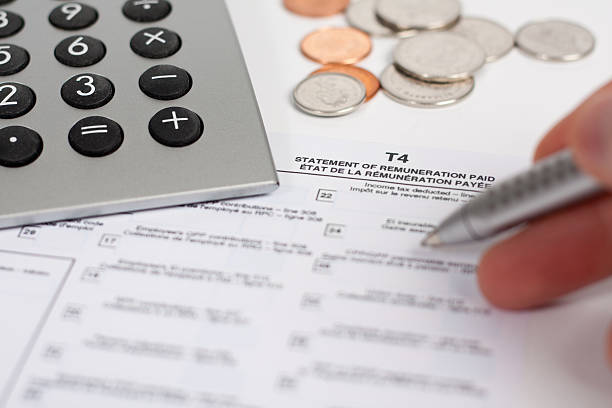 Calculator, Tax Form, Pen and Coins