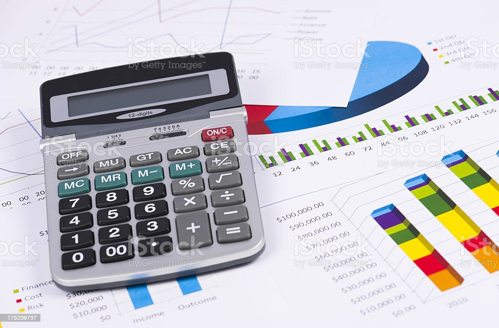 Calculator with business charts royalty-free stock photo