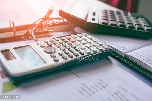 istock Calculator with business graphs and charts report on tabble, calculator on desk of financial planing. Financial abstract concepts. 814111118