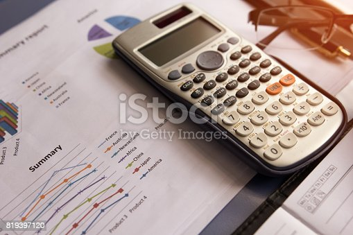 istock Calculator with business graphs and charts report 819397120