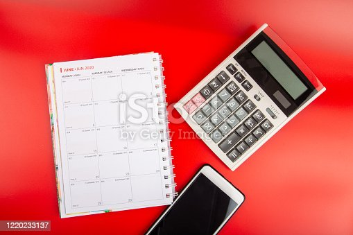 1136634036 istock photo Calculator with daily book calendar, Smartphone and Tax Words-Financial Concept 1220233137