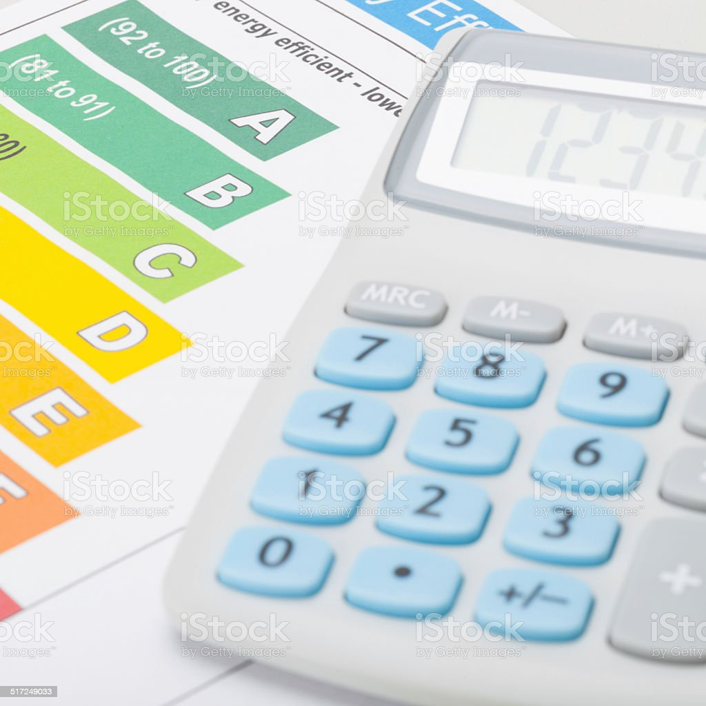 Calculator with energy efficiency chart  - 1 to 1 ratio - Royalty-free Banking Stock Photo