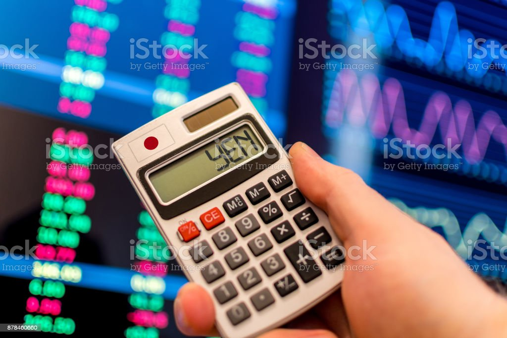 Calculator with Japanese Flag and YEN on screen stock photo