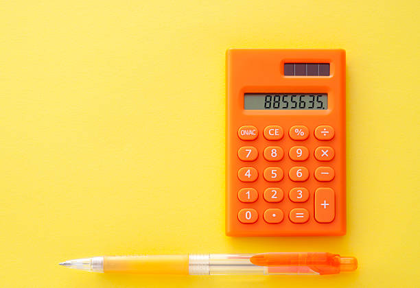 Calculator with mechanical pencil stock photo