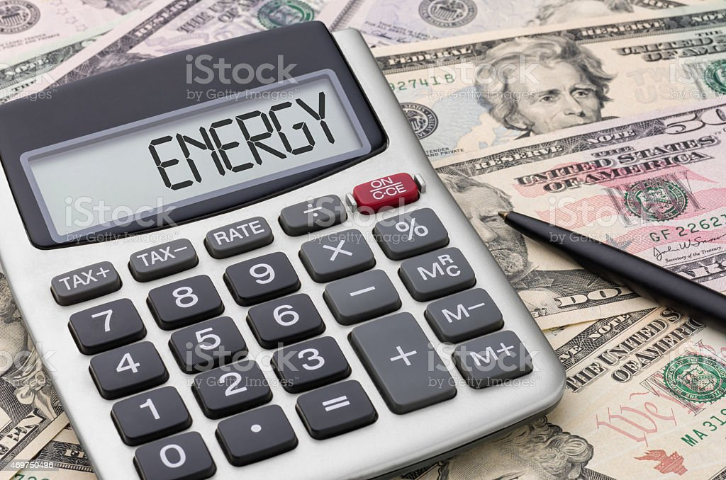 Calculator with money - Energy stock photo