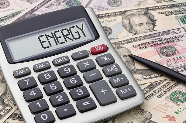 калькулятор, деньги-энергия - dollar bill стоковые фото и изображения