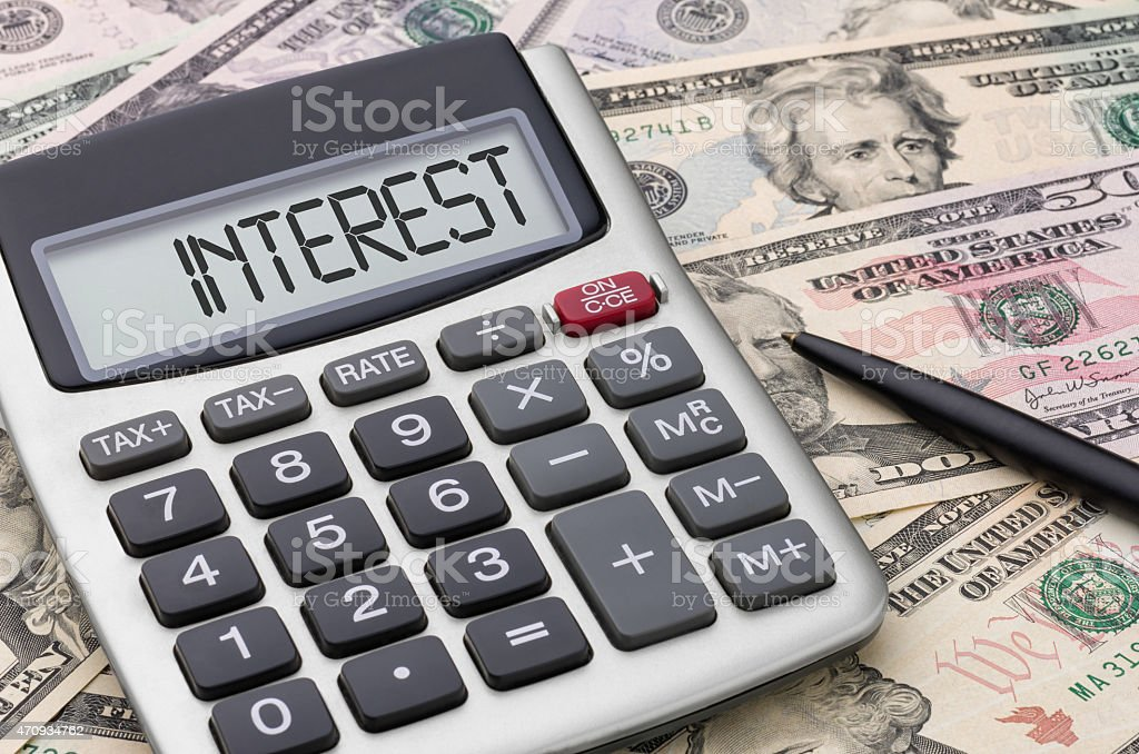 Calculator with money - Interest stock photo