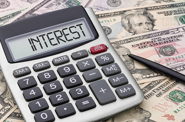 calculator with money - interest - interest rate stock photos and pictures