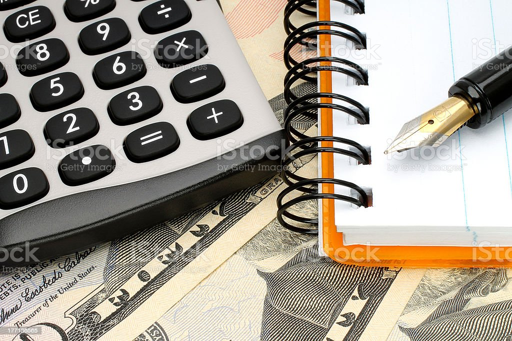 Calculator with notepad on money royalty-free stock photo
