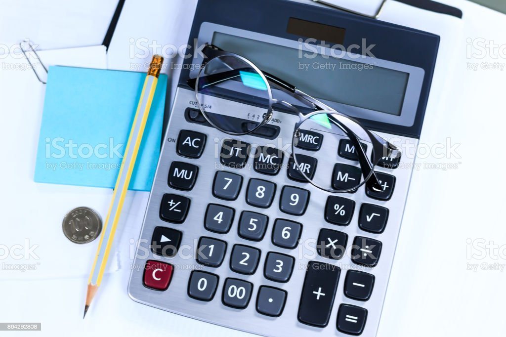 Calculator with pencil and glasses with notes royalty-free stock photo