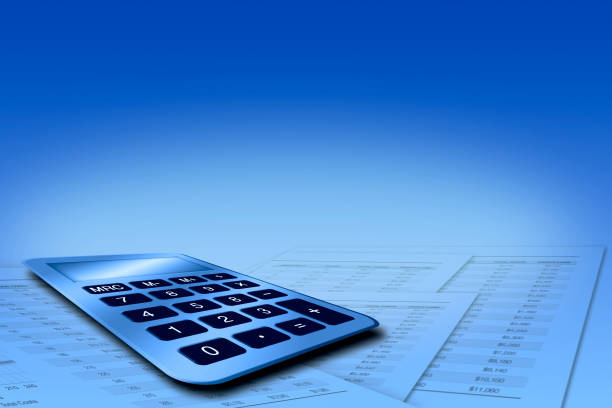 Calculator with Speadsheets on Blue Backgraound stock photo