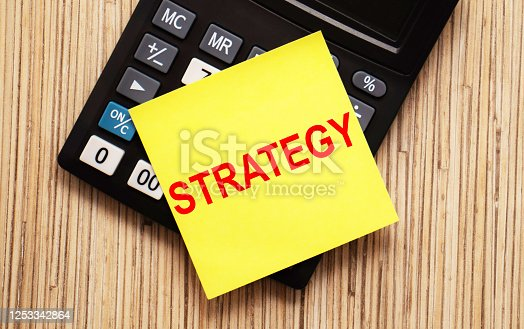 947260978 istock photo calculator with text STRATEGY with yellow paper 1253342864