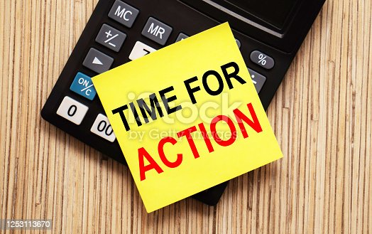 947260978 istock photo calculator with text TIME TO ACTION with yellow paper 1253113670