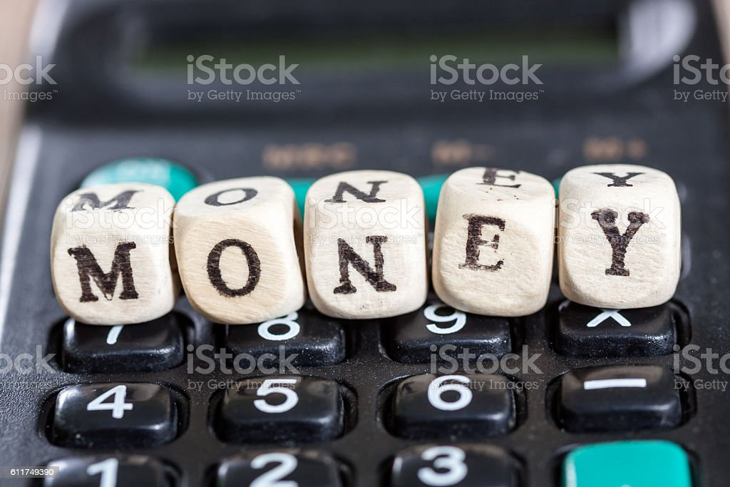 Calculator with the word money stock photo