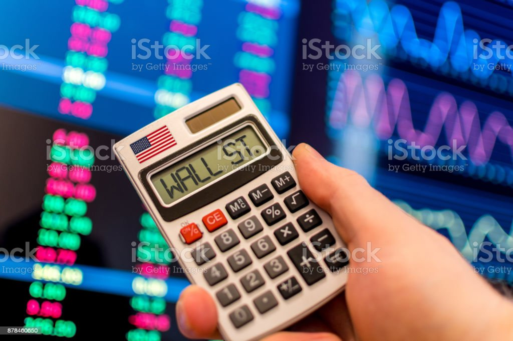 Calculator with USA Flag and Wall St. on screen stock photo