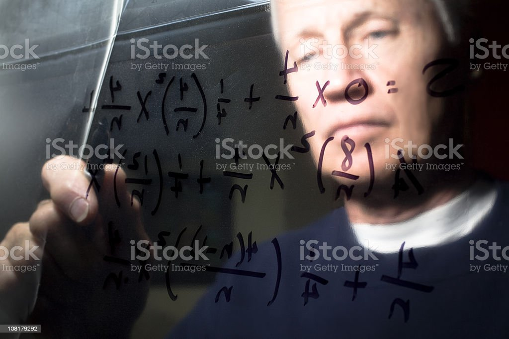 Calculus equation on a clear dry erase board with man stock photo