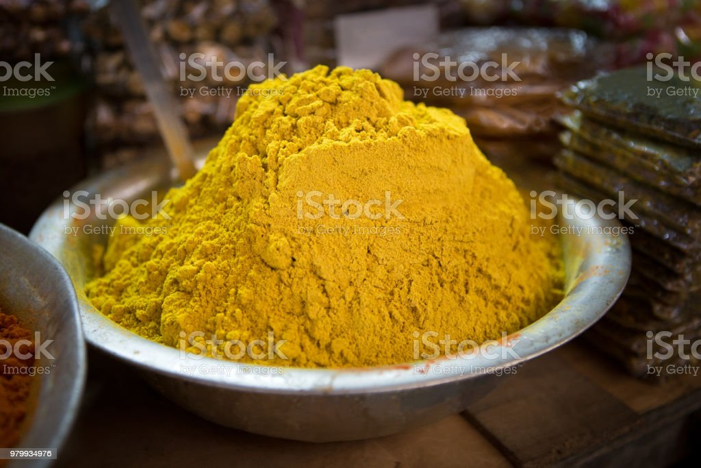 a scale with curry powder on a food market in puducherry in the south...